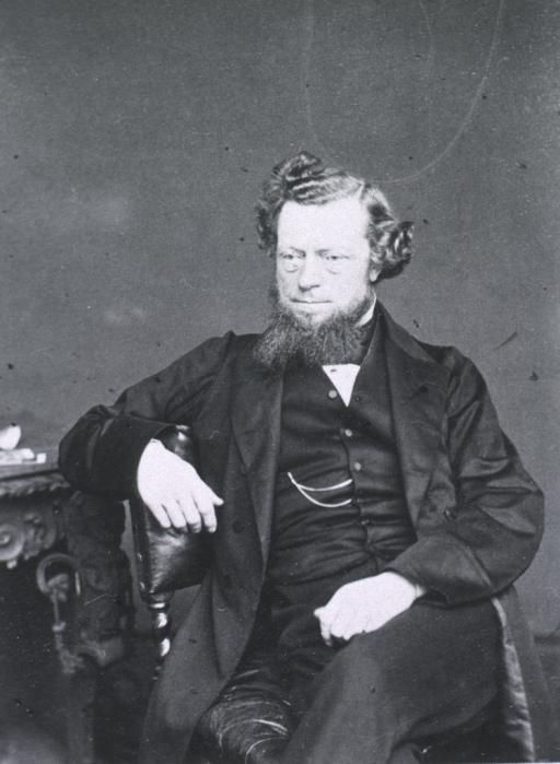 <p>Seated with right arm over chair; left pose.</p>