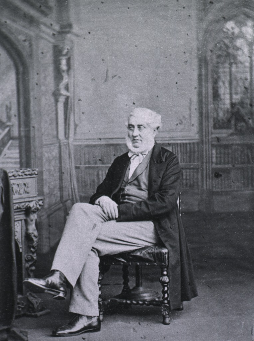 <p>Seated with legs crossed and hands in lap; left pose.</p>
