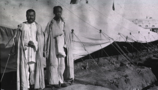 <p>Two patients standing outside a tent at Kaufman No. 2 Red Cross Hospital.</p>