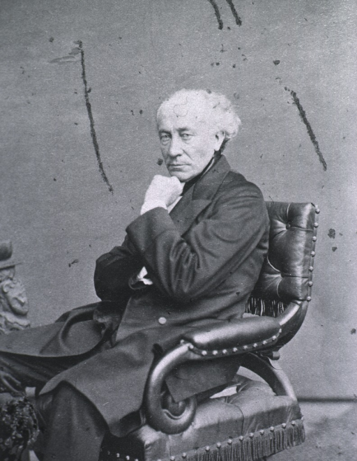 <p>Seated with chin resting between left thumb and forefinger; left pose.</p>
