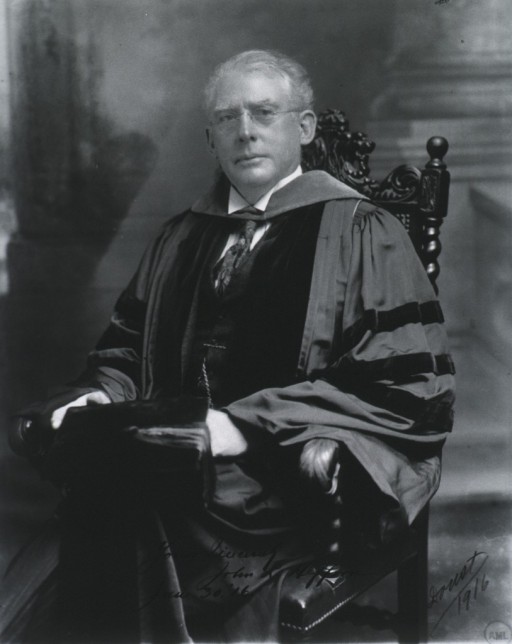 <p>Three-quarter length, seated, left pose, full face; wearing academic robes.</p>