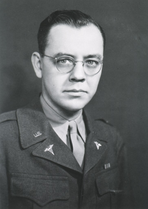 <p>Head and shoulders, full face, glasses.</p>