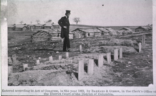 <p>A bearded man wearing a frock coat and tall hat (intended to represent President Abraham Lincoln?) stands at the graves of soldiers who died during the Battle of Bull Run. [For a discussion regarding the identity of the man in this photograph, see JAMA, vol. 302, no. 5, August 5, 2009, letter to the Editor from Stephen J. Greenberg, MSLS, PhD.]</p>