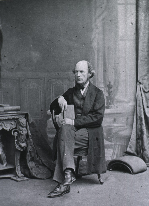 <p>Seated with right arm over the chair, holding a book; left pose.</p>