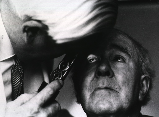 <p>A physician is examining the eyes of an old man for signs of diabetes.</p>