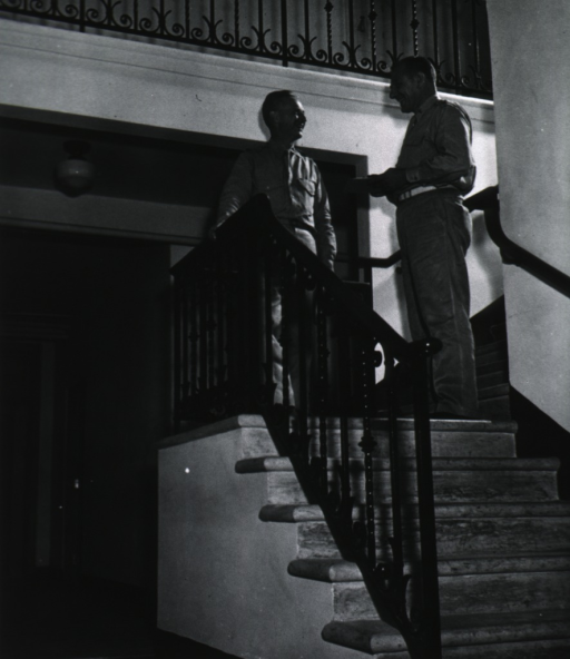 <p>Full length, standing on stairway with another officer; wearing uniform.</p>