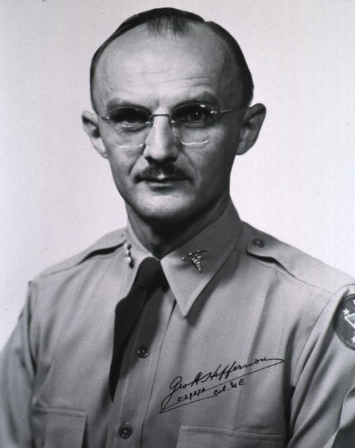 <p>Head and shoulders, left pose, full face; wearing uniform (Colonel) and glasses.</p>