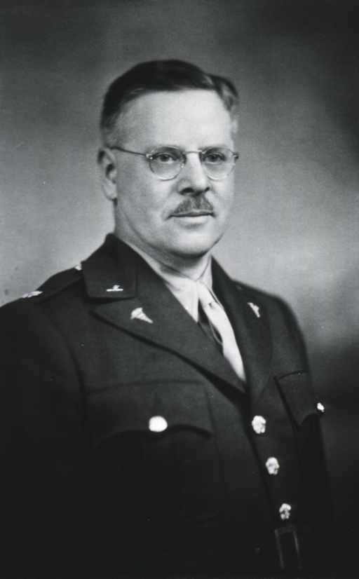 <p>Half-length, standing, right pose, full face; wearing uniform and glasses.</p>