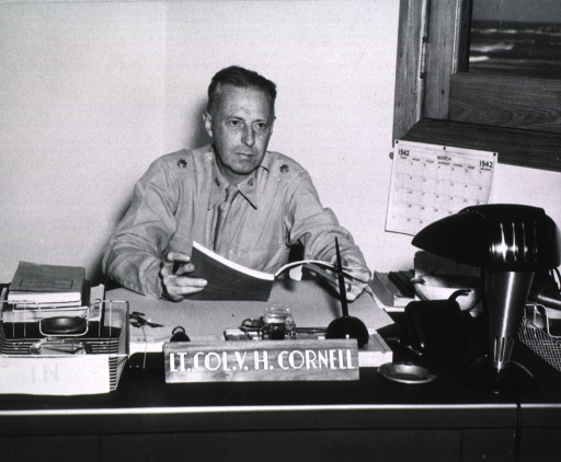 <p>Seated at desk, holding book, full face, wearing uniform (Lieut. Colonel).</p>
