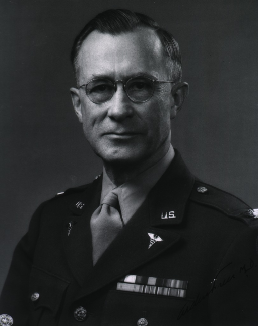 <p>Head and shoulders, full face, wearing uniform (Colonel, M.C.).</p>