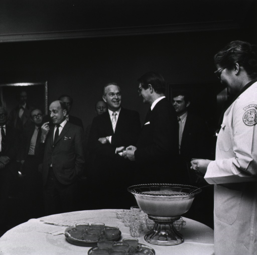 <p>CC Nutrition Chief Edith Jones serves refreshments to Elliot Richardson during his visit to NIH on March 16, 1971.  Among others shown are Dr. Donald Fredrickson, Dr. Robert Berliner, and DeWitt Stetten.</p>