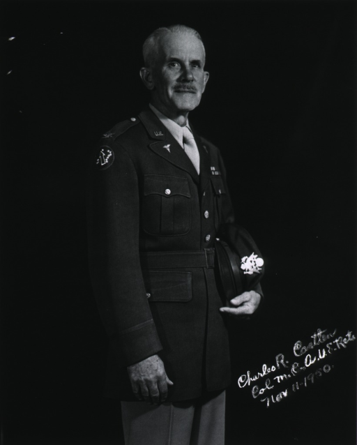 <p>Standing, face front, wearing uniform (Colonel), holding cap.</p>
