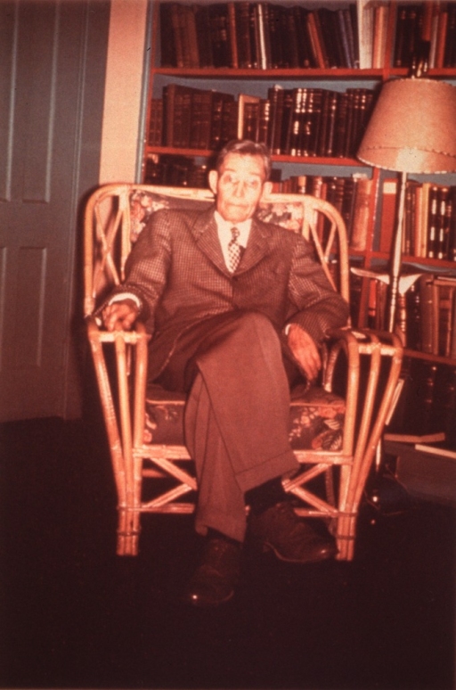 <p>Full length, seated in arm chair.</p>