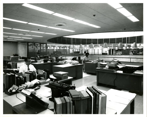 <p>Three staff members from the Bibliographic Services Division Index Unit at the National Library of Medicine perform indexing duties on the mezzanine level.</p>