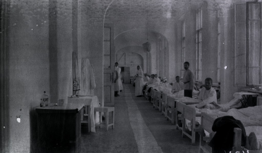 <p>Patients, a nurse and medical personnel in a ward at Kinishenski Red Cross Hospital.</p>