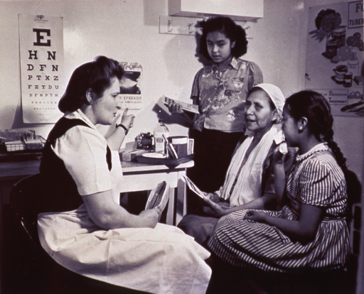 <p>A young girl and her mother receive instruction for preventing the spread of disease.</p>