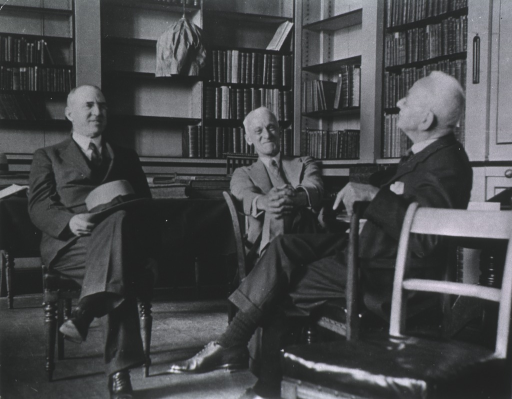 <p>Seated with two others in the Royal Surgeons Library, London.</p>