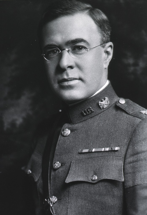 <p>Standing, three quarter length, arms behind back; in uniform.</p>