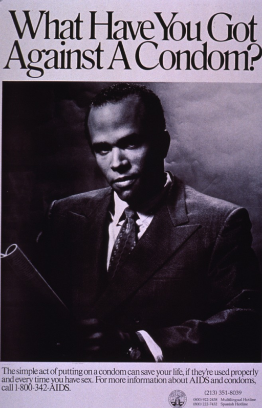 <p>Black and white poster of an African American young man in a suit and tie looking up as he holds a magazine in his hands.</p>