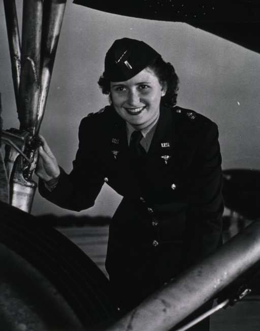 <p>Half-length, full face, wearing dress uniform, standing under an airplane.</p>