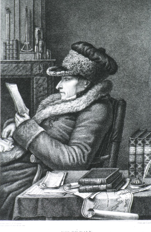 <p>Shows Peron seated reading, wearing long coat &amp; fur-trimmed cap.  Left pose, books on table in foreground.</p>