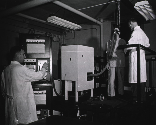 <p>A man walking on a treadmill breathes into a mask connected to a device to measure changes in composition; another man monitors his blood pressure while a man monitors the machinery to which the first man is connected.</p>