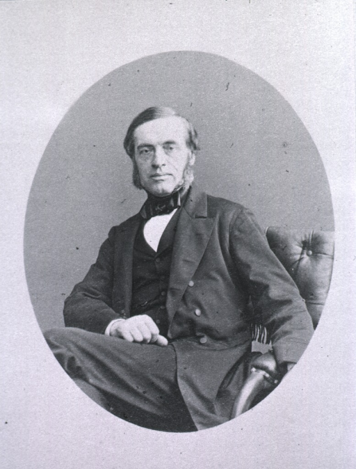 <p>Seated with legs crossed, right hand is resting on leg; left pose.</p>