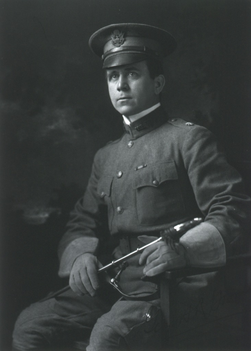 <p>Three-quarter length, seated, left pose; wearing uniform, cap, and gloves; holding sword.</p>