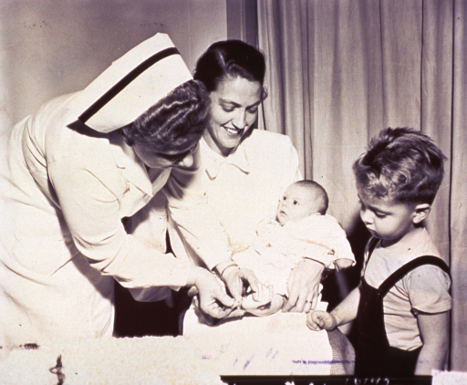 <p>A nurse is taking a blood sample from the foot of an infant.</p>