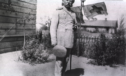 <p>Dr. Lausen, Chief Surgeon at Military Hospital No. 16, standing outside.</p>