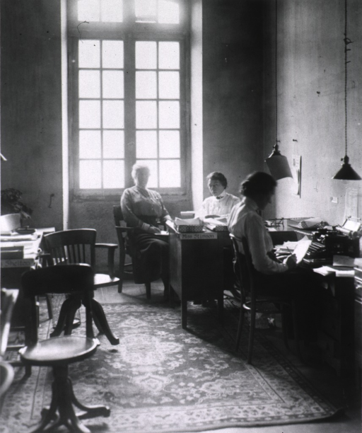 <p>Interior view of Chief Surgeon's office showing staff members Nena Shelton, Hilda Keller, and J.R. Balch.</p>