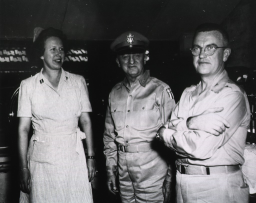 <p>Two men in military uniform stand next to a nurse in uniform.</p>