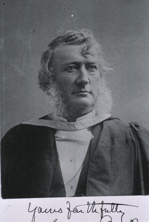 <p>Head and shoulders, right pose, wearing academic gown.</p>