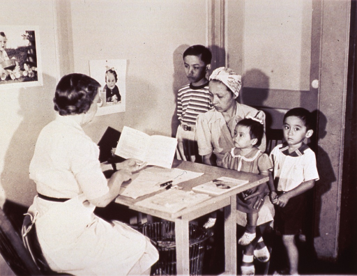 <p>A mother and her children receive health care instruction.</p>