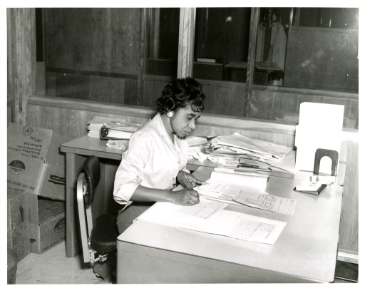 <p>A Bibliographic Services Division proofreader checks hard copy against data sheet and journal at the National Library of Medicine.</p>