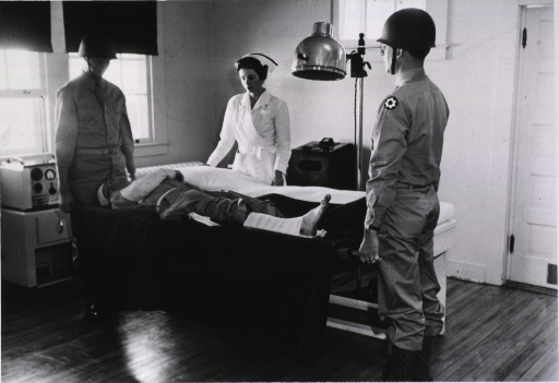 <p>Patient being brought in on stretcher for ultra violet ray treatment.</p>