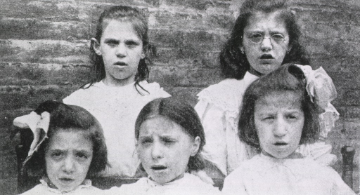 <p>Exterior view: head and shoulders, of five young girls; all are apparently breathing through the mouth.</p>