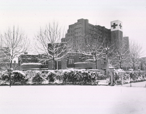<p>Exterior view of the multi-story hospital, covered in snow.</p>