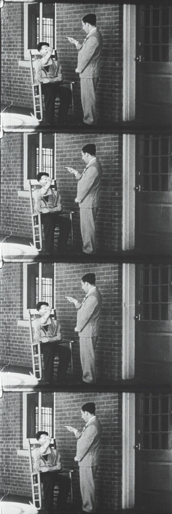 <p>Images from silent film. Four frames show doctor interviewing a patient, with patient mimicking the doctor's gestures.</p>