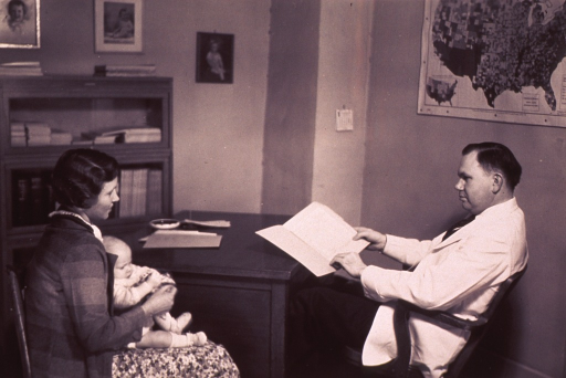 <p>A post-examination conference between the physician and the mother.</p>