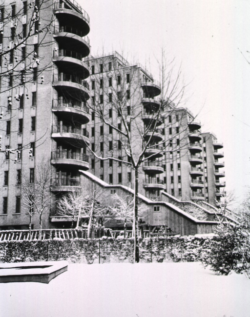 <p>A group of high rise buildings are shown in winter.  Snow covers the ground.</p>