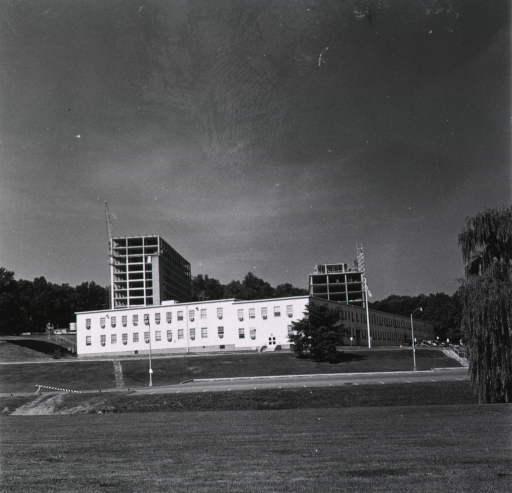 <p>Exterior view showing Building 31, A-Wing and B-Wing, under construction.  Building T-6 is in the foreground.</p>