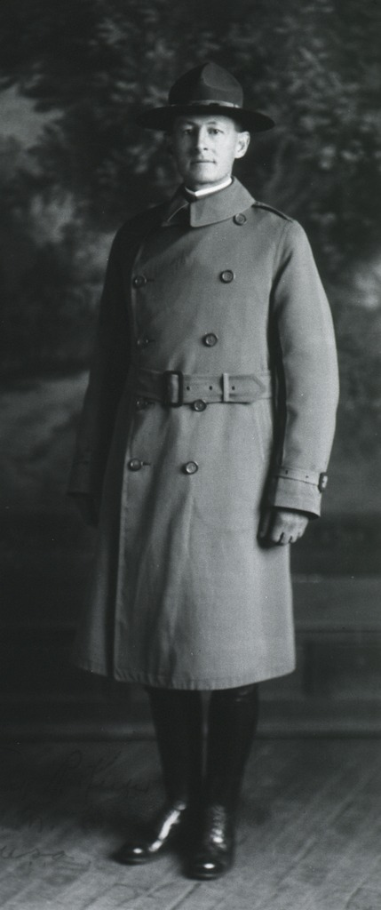 <p>Full length, standing, full face; wearing overcoat and hat.</p>