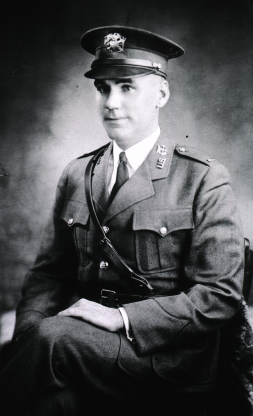 <p>Seated, facing left, U.S. Army uniform and cap.</p>