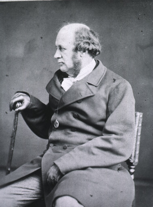<p>Seated with right hand on cane; left pose.</p>