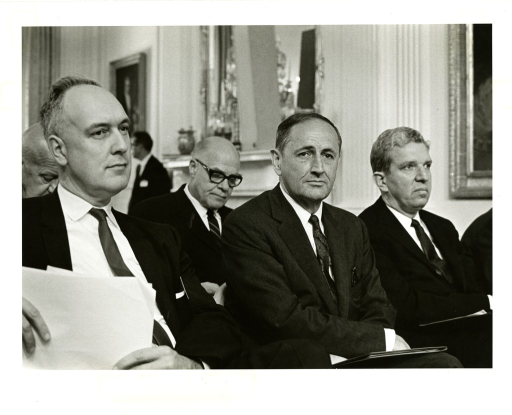 <p>Surgeon General William H. Stewart (left) and John W. Gardner, Secretary of Health, Education, and Welfare (second from the right), attend a White House meeting on the topic of Medicare in 1965.</p>
