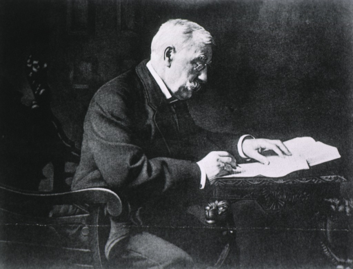 <p>Seated, right profile, writing.</p>