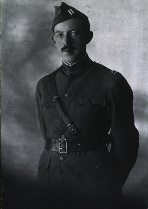<p>Three-quarter length, standing, full face, wearing uniform and cap.</p>