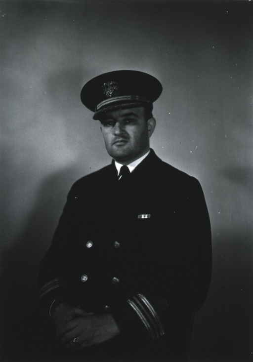 <p>Three-quarter length, seated, full face, body to left, hands clasped, wearing USPHS uniform and cap.</p>