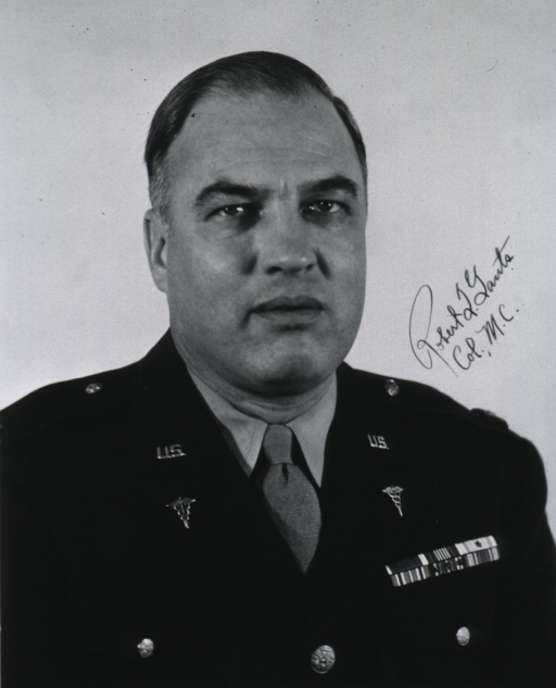 <p>Head and shoulders, full face; wearing uniform (Colonel).</p>